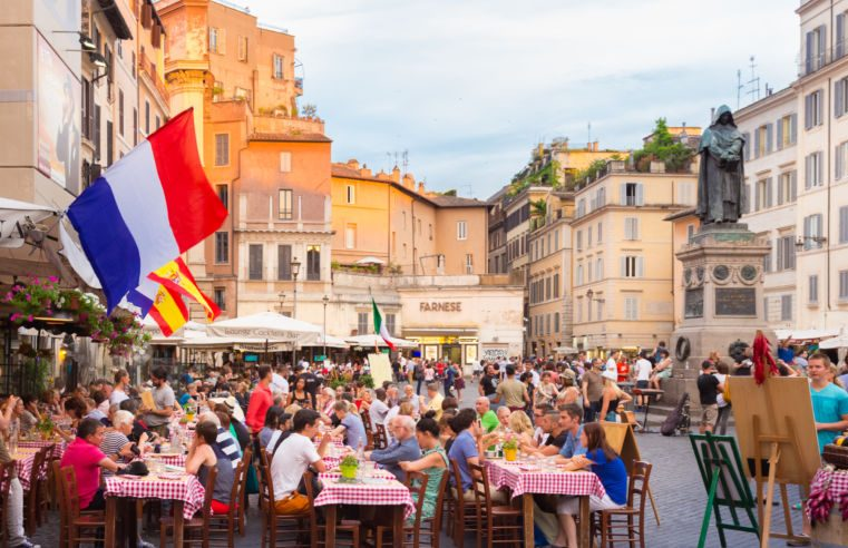 Tourists eating outside Pizza in Rome